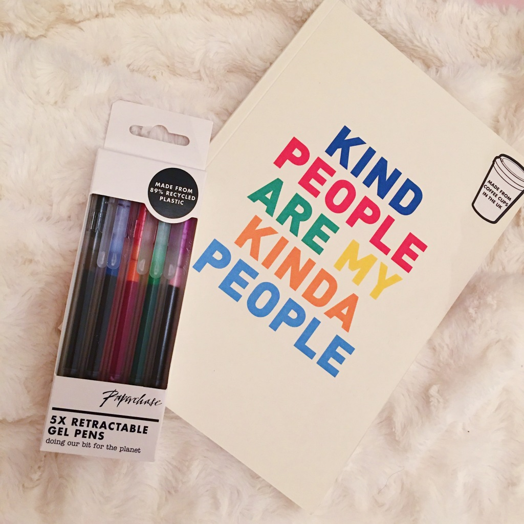 products from Paperchase sustainable range. A notebook with the slogan Kind People are my Kind of People which is made from recycling coffee cups, and a pack of 5 retractable coloured gel pens made from recycled materials